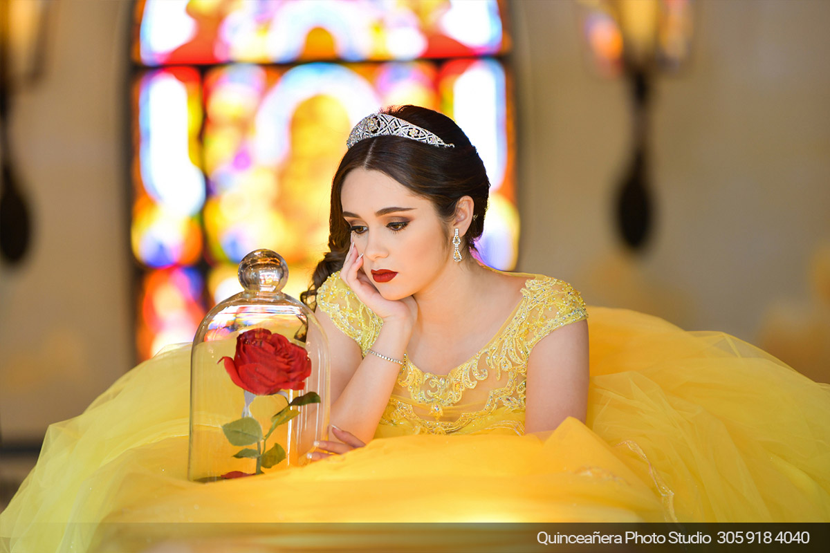 Beautiful quinceañera with a yellow dress of beauty and the beast. Photo by Quinceanera Photo Studio 305.918.4040