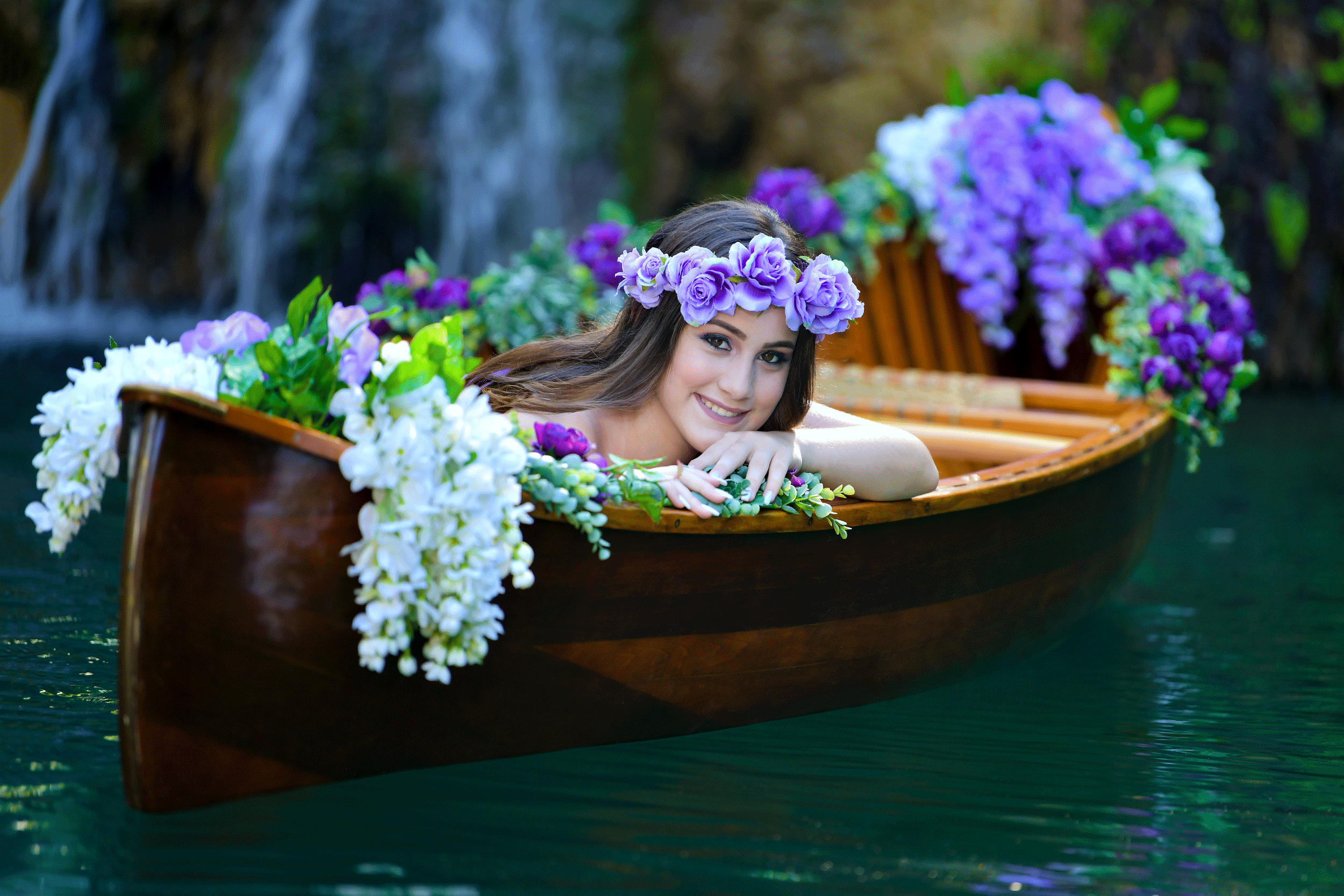Quinceanera in a flower canoe Photo by Quinceanera Photo Studio in Miami Florida.