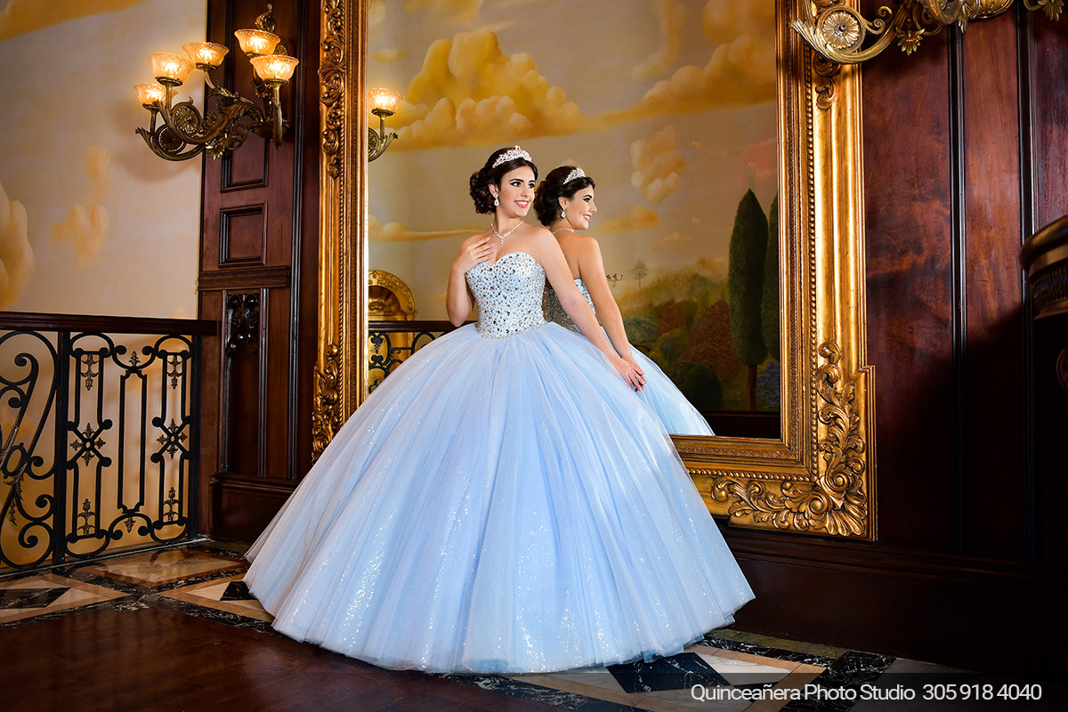 Quinceañera in The Cruz Building with blue dress, Photo by Quinceanera photo studio (304) 918-4040