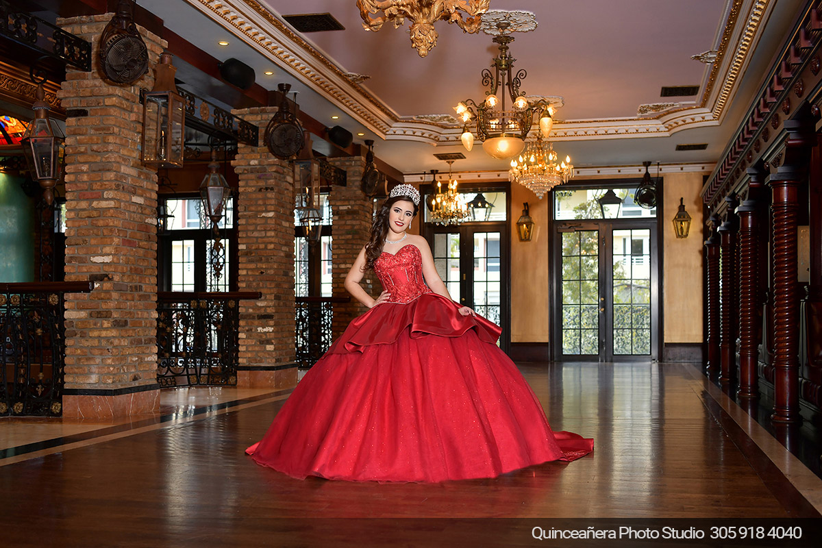 Quinceanera in The Cruz Building with burgundy dress. Photo by Quinceanera Photo Studio 305.918.4040