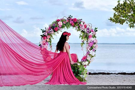 Beautiful photo of a quinceanera on the beach. Photo by Quinceanera Photo Studio 305.918.4040